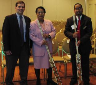 Shirley Jackson, Sandeep Nandy, and Dave Aiello with hockey sticks